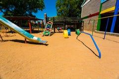 Corrediça pré-escolar colorida vazia do campo de jogos foto de stock royalty free