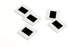 Corrediças com frames plásticos no llightbox Imagem de Stock