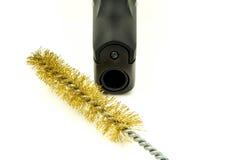 Corredo di pulizia della pistola Fotografie Stock Libere da Diritti