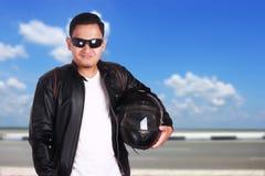 Corredor asiático del motorista de la moto imagen de archivo