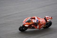 Corredor de la motocicleta en la acción Imagen de archivo libre de regalías