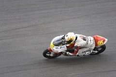 Corredor de la motocicleta en la acción Imagen de archivo