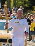 Corredor de relé olímpico de 2012 tochas Imagem de Stock