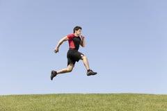 Corredor do homem do atleta fotografia de stock