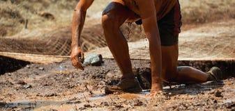 Corredores de raça da lama Fotografia de Stock