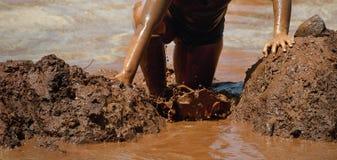 Corredores de raça da lama Fotos de Stock Royalty Free