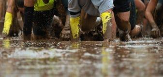 Corredores de raça da lama Imagem de Stock