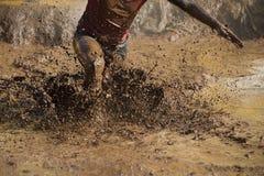 Corredores de raça da lama Foto de Stock Royalty Free