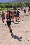 Corredores 2014 de raza del fango de Muderrella Foto de archivo