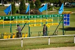 Corredores e cavaleiros, pista de corridas de Tailândia Fotos de Stock Royalty Free