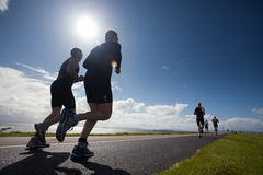 Corredores, triathlon Fotos de archivo libres de regalías