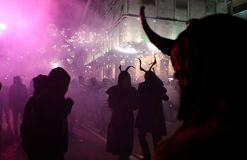 Correfoc in palma during saint sebastian local patron festivities close. Palma de Mallorca, Spain, January 21st, 2018. Revellers dressed as devils and holding Royalty Free Stock Photography