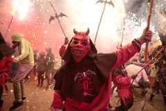 Correfoc in palma during saint sebastian local patron festivities. Revellers dressed as devils and holding fireworks take part in a traditional Correfoc fire run Royalty Free Stock Photos