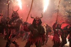 Correfoc in palma during saint sebastian local patron festivities. Revellers dressed as devils and holding fireworks take part in a traditional Correfoc fire run Stock Image