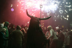 Correfoc sant sebastian 018. Men dressed as devils or evil hords and holding sticks with fireworks seen during a correfoc in the spanish island of mallorca Stock Images