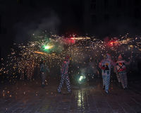 Correfocs (fire runs) - essential part of tradition originating Royalty Free Stock Images