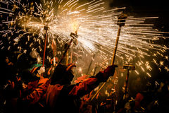 Correfocs. Or fire runs are held every year in different towns in Catalonia, Spain. People dressed as devils carry pitchforks with fireworks and run through the Royalty Free Stock Photo
