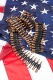 Correia de Cartidge em uma bandeira americana Fotos de Stock Royalty Free