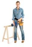 Correia de With Drill And do trabalhador da construção que está pelo cavalo do trabalho imagens de stock royalty free