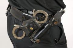 Correia de serviço público da polícia com punhos e bastão Imagem de Stock