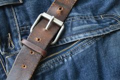 Correia e calças de brim velhas Imagem de Stock