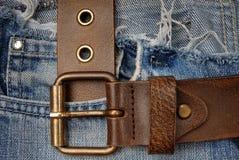 Correia e calças de brim Fotografia de Stock Royalty Free