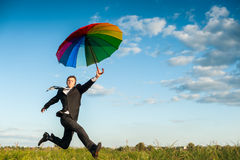 Correndo con l'ombrello Fotografia Stock Libera da Diritti