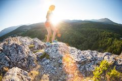 Correndo nelle montagne Fotografia Stock