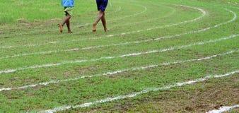 Correndo sulle linee bianche pista Immagine Stock Libera da Diritti