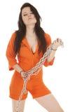 Corrente alaranjada da prisão da mulher na parte dianteira Fotos de Stock Royalty Free