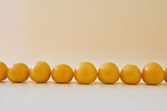 Corrente de bagas douradas Foto de Stock