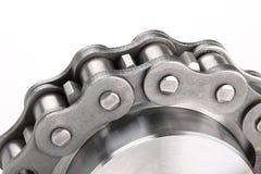Corrente de ligação do metal e roda denteada Imagens de Stock