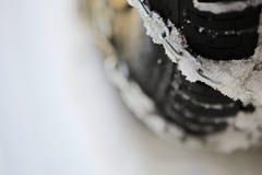 A corrente de pneu na neve Foto de Stock Royalty Free