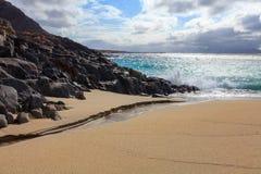 Corrente su una spiaggia sabbiosa Fotografia Stock