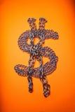 Correntes do dólar no fundo alaranjado Imagem de Stock Royalty Free