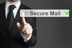 Correo seguro del botón del tacto del hombre de negocios Imagen de archivo