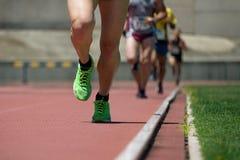 Correre della gente di atletica Fotografie Stock Libere da Diritti