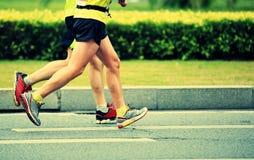 Correre maratona degli atleti Fotografia Stock Libera da Diritti