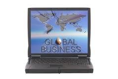Correspondencia de mundo del asunto global en la pantalla de la computadora portátil Imagen de archivo
