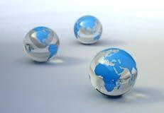 Correspondencia de mundo en las esferas de cristal Imagenes de archivo