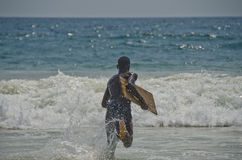Corrida ao longo da praia Imagem de Stock Royalty Free