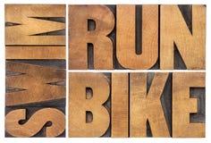 Corrida, bicicleta, nadada - conceito do triathlon Imagem de Stock Royalty Free