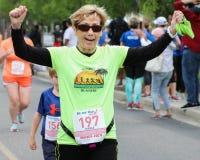 Corrida da corrida 5K das mamãs Imagem de Stock
