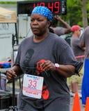 Corrida da corrida 5K das mamãs Foto de Stock