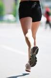 Corrida de la mujer del maratón Imagen de archivo libre de regalías