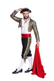 Corrida de Toros. Man in a matador costume with a red cape. Isolated on a white background Stock Photo