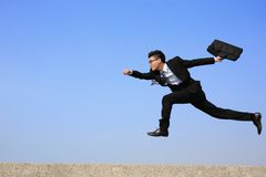 Corrida feliz do homem de negócio Foto de Stock Royalty Free
