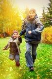 Corrida feliz dos meninos Foto de Stock Royalty Free