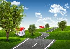Corridas da estrada através dos montes verdejantes Fotografia de Stock