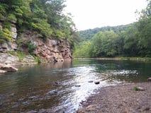 Corridas do rio com ele Imagem de Stock